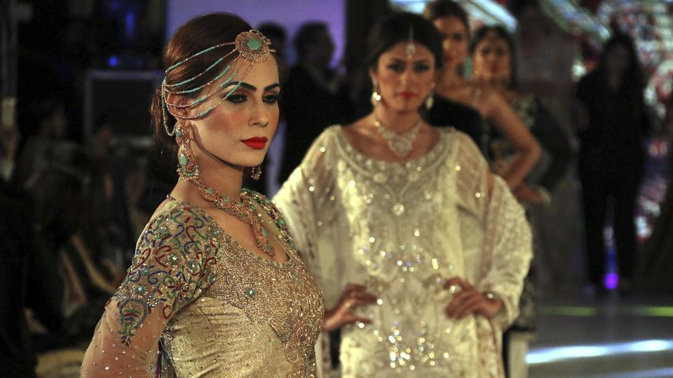 Models showcase creations by designers of label Nauratan during a fashion show in Peshawar. (AP)