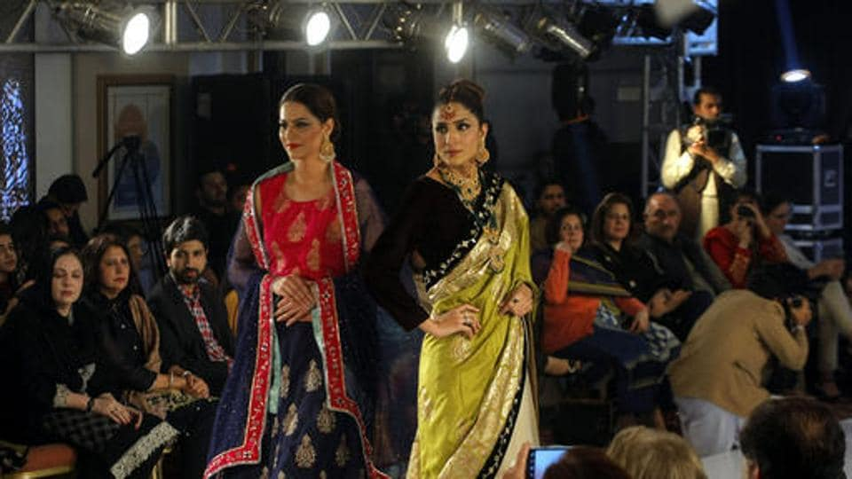Models walk the ramp at a fashion show in Peshawar, Pakistan. The show aims to introduce new trends in the city. (AP)