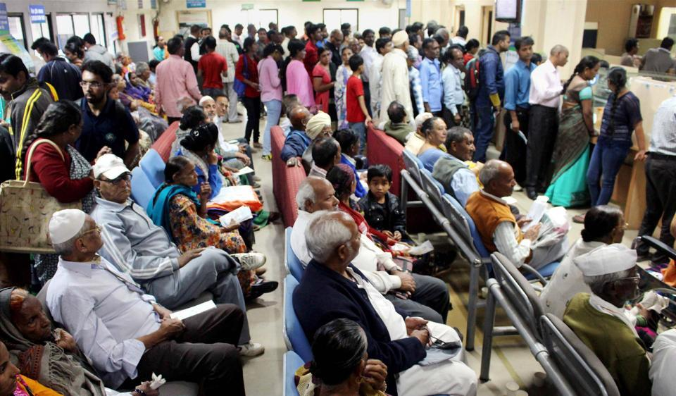 People queue up inside a bank to withdraw cash in Bhopal on Thursday.