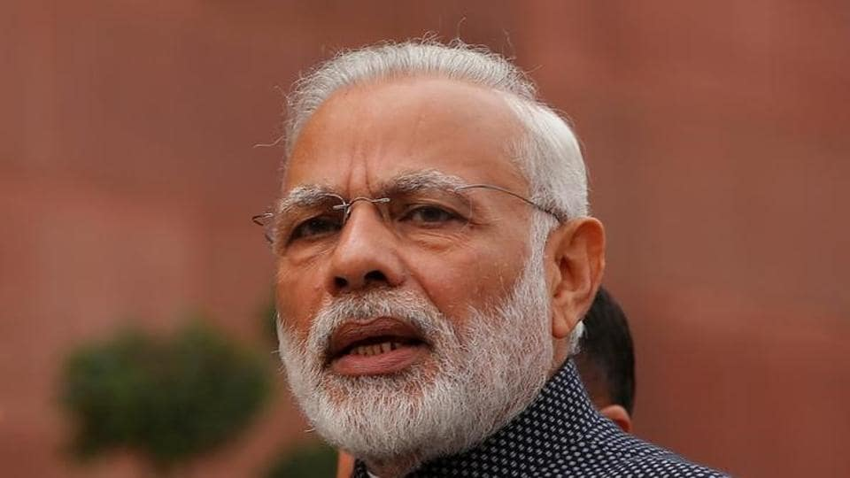 Prime Minister Narendra Modi speaks to the media inside the parliament premises in New Delhi.