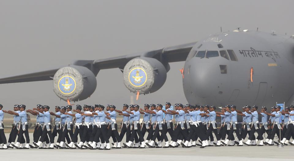IAF soldiers march past their C-17 Globemaster military transport aircraft during a parade at the Hindon air base.
