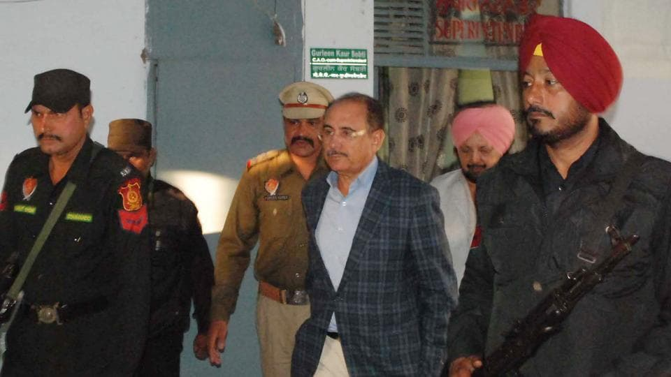 Former Punjab DGP SK Sharma (centre) at the Rupnagar courts on Saturday.