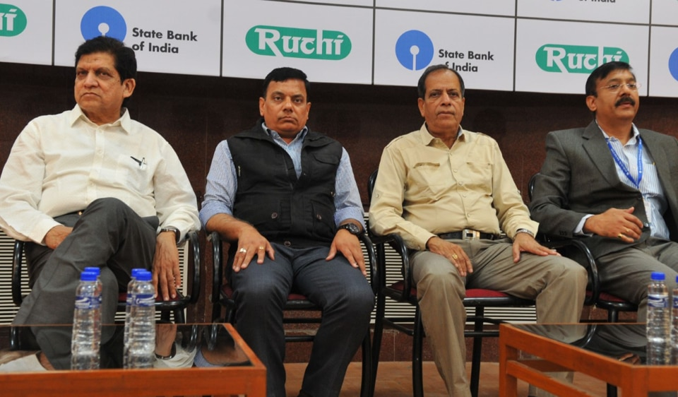 Virendra Kumar, regional manager of SBI, (far right) along with Varad Murti Mishra, additional collector, (second from left) addressing a press conference in Indore on Friday.