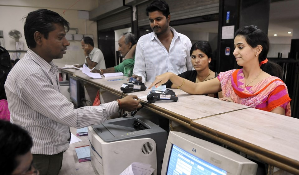 People using swipe machines after the collector's order to make cashless transactions at the collectorate, in Indore on Friday.