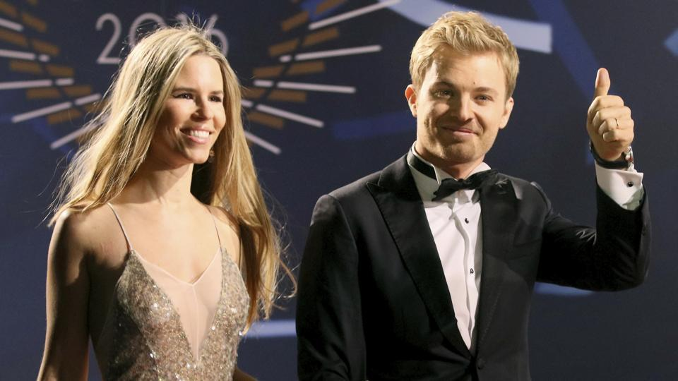Formula One world champion Nico Rosberg, who announced his retirement on Friday, arrives with his wife Vivian Sibold at a FIA gala at Hofburg Palace in Vienna on Friday. Rosberg received his F1 championship trophy at the Gala.