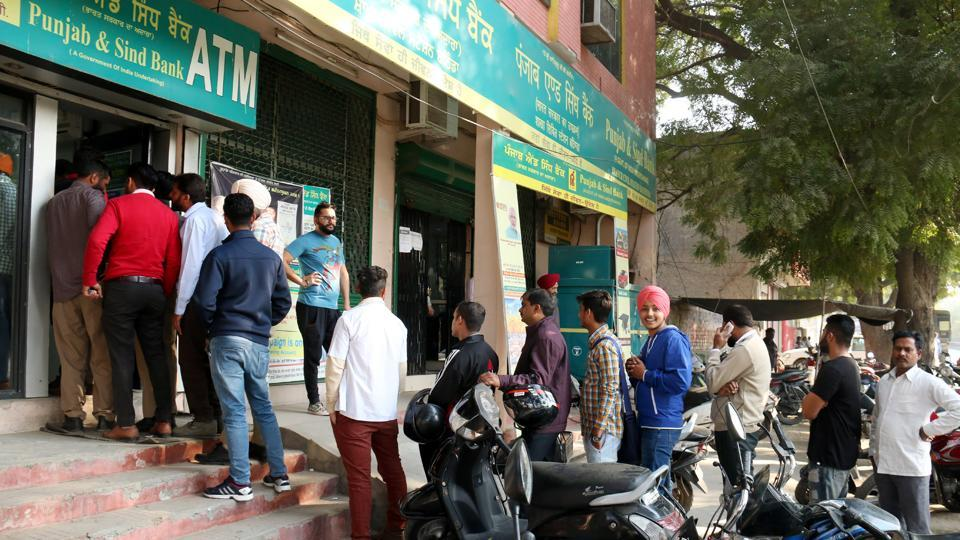 A long queue at a Punjab and Sind Bank ATM in Bathinda on Friday.
