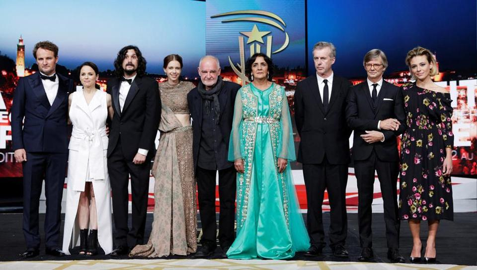 Jury members pose on stage during the opening ceremony of the 16th Marrakech International Film Festival in Marrakesh, Morocco, on Friday.  (Reuters)