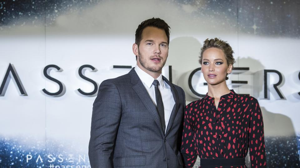 Actors Chris Pratt and Jennifer Lawrence pose for photographers during a photo call to promote the film Passengers in London. (AP)