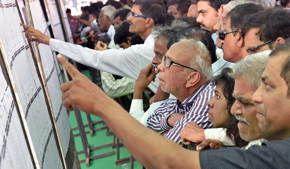 Mill workers and their relatives check their names in MHADA lottery list at Hotel Rangsharda, Bandra, on Friday.