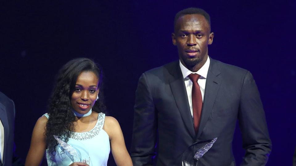 Usain Bolt and Almaz Ayana pose with their awards after being elected male and female World Athlete of the Year 2016 in Monaco.