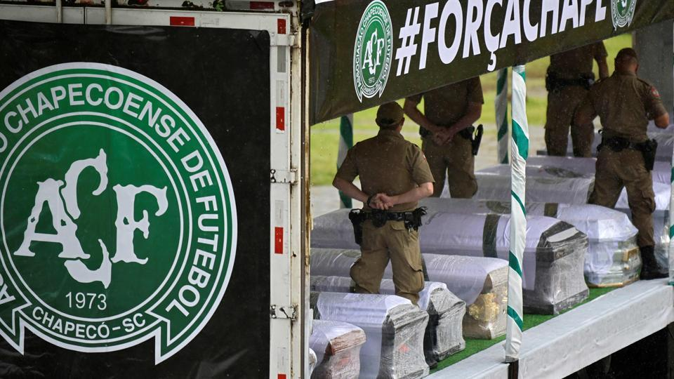 Soldiers carry the coffins of the members of the Chapecoense Real football club. The bodies of 50 players, coaches and staff from a arrived home Saturday for a massive funeral.
