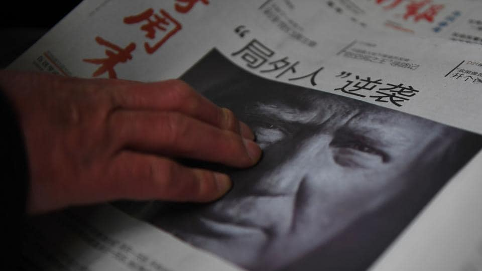 A newspaper in Beijing featuring a photo of US president-elect Donald Trump.