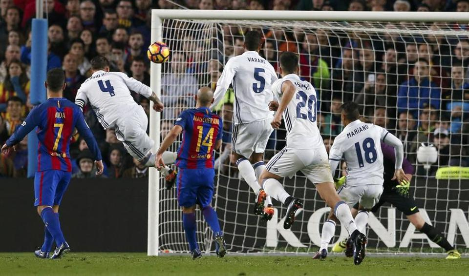 Sergio Ramos charged in to head Luka Modric's free kick past goalkeeper Marc-Andre ter Stegen, who got a hand on the ball but couldn't keep it out.