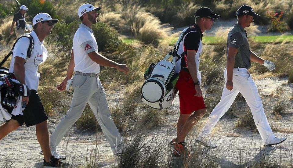 Henrik Stenson (R) of Sweden walks with tee-off partner Dustin Johnson (second from left) of the United States who is in joint lead with Hideki Matsuyama  after the second round of the Hero World Challenge at Albany, the Bahamas. Tiger Woods hit a bogey-free round on Friday, and is six shots behind the co-leaders.