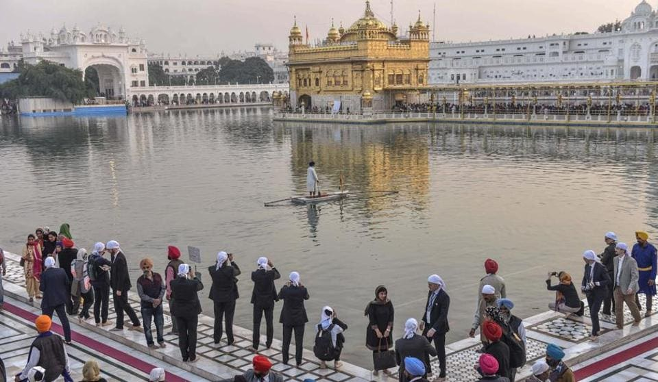 Delegates at the Heart of Asia meet clicking photos during a visit to the Golden Temple in Amritsar on Saturday.  (Gurpreet Singh/HT)