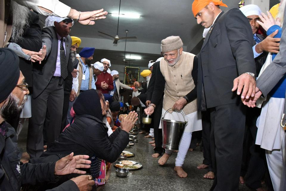 Modi also served Langar in the community kitchen of the shrine as Ghani stayed along with him. (PTI Photo)