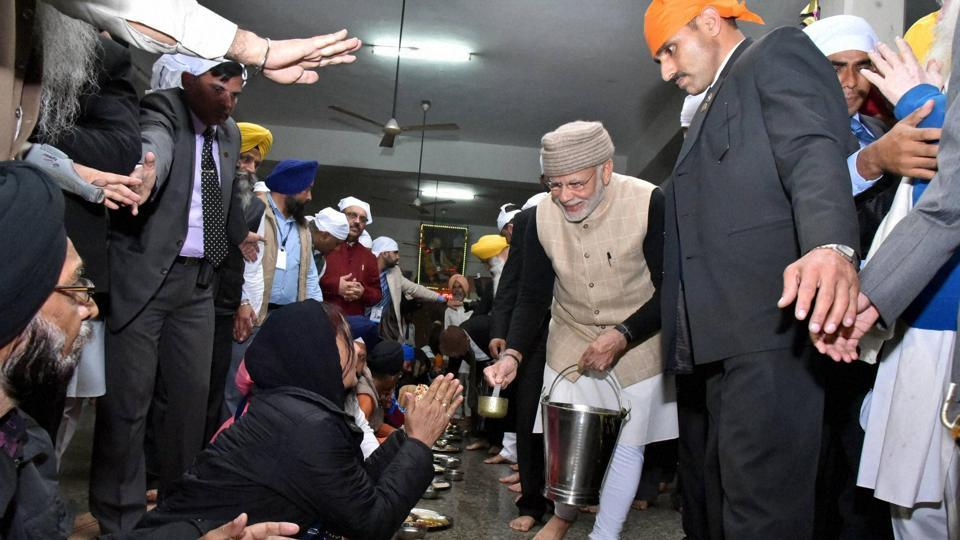Prime Minister Narendra Modi serves langar during his visit at the Golden Temple in Amritsar on Saturday. (PTI)