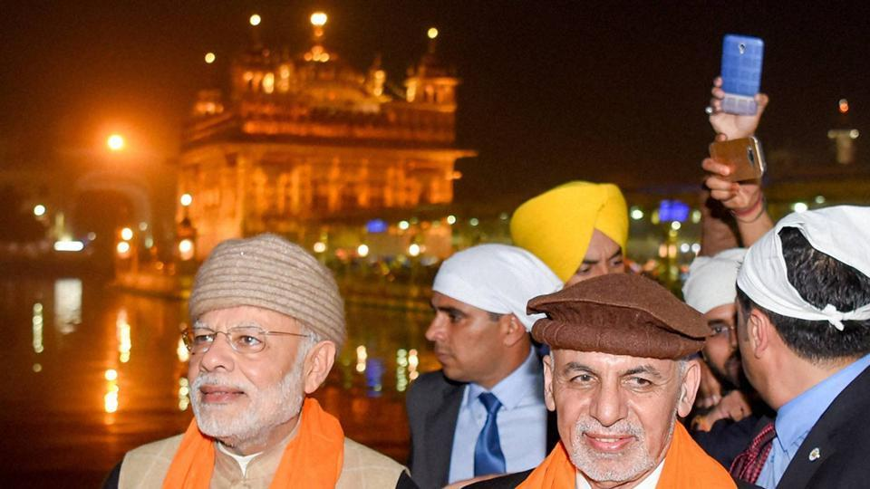 Prime Minister Narendra Modi and Afghanistan's President Ashraf Ghani at Golden temple on the eve of the Heart of Asia Conference, in Amritsar on Saturday. (PTI Photo)
