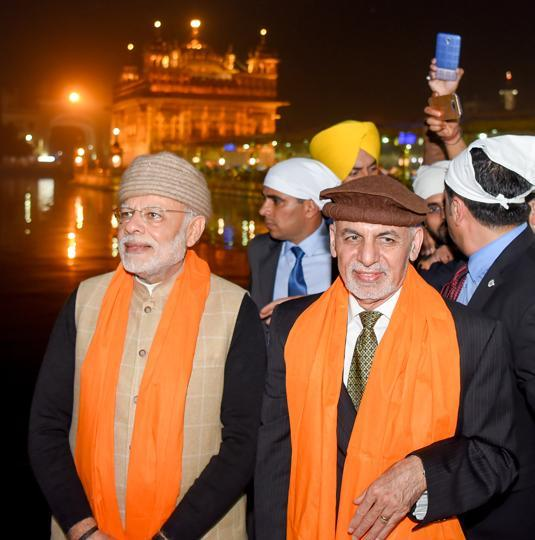 M Narendra Modi with Afghanistan President Ashraf Ghani at the Golden Temple in Amritsar on Saturday. On Sunday, they will be part the Heart of Asia conference. (Photo: Punjab CMO)