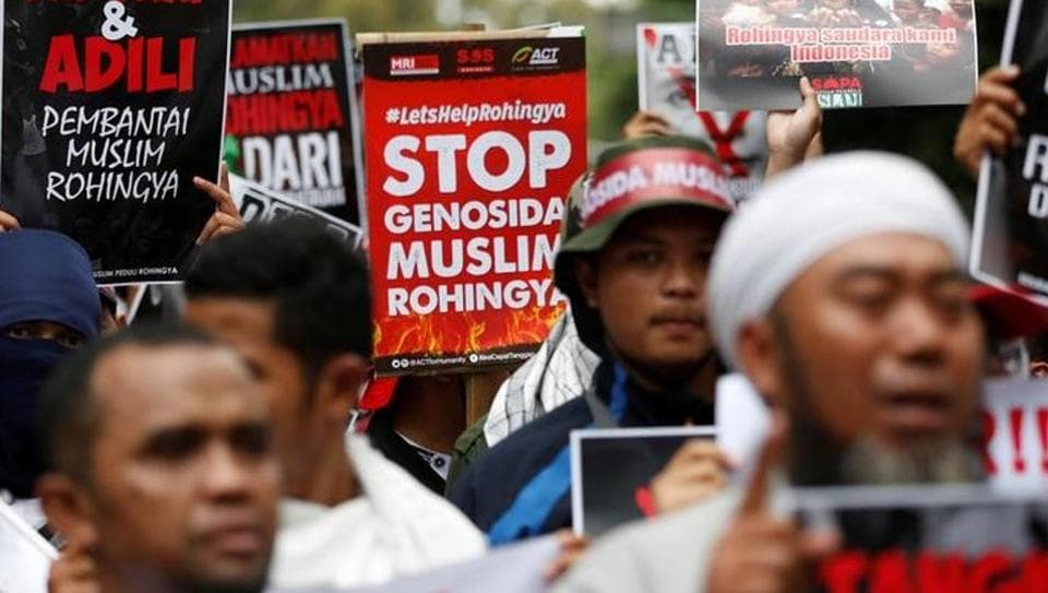 Protesters hold signs during a demonstration against what organisers say is the crackdown on ethnic Rohingya Muslims in Myanmar, outside the Myanmar embassy in Jakarta, Indonesia on November 25.