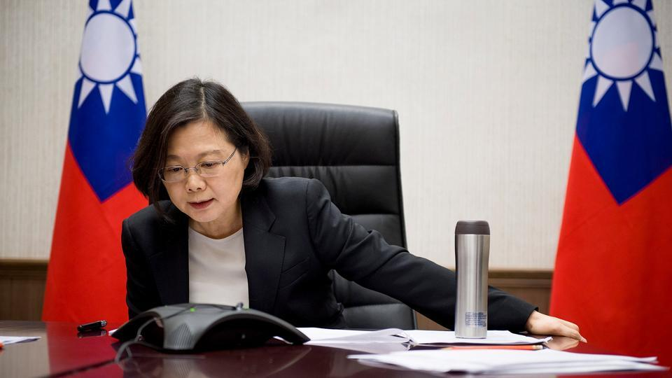 Taiwan's President Tsai Ing-wen speaks on the phone with US president-elect Donald Trump at her office in Taipei, Taiwan.