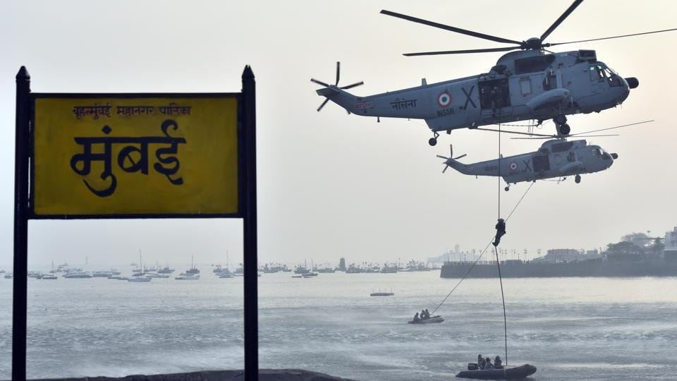 Marine commandos demonstrate rescue operation during Navy Day celebration at Gateway of India. (Pratham Gokhale/HT PHOTO)