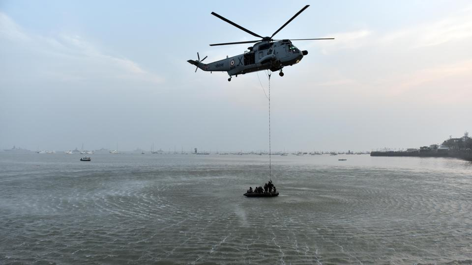 Marine commandos demonstrate rescue operation during Navy Day celebration at Gateway of India in Mumbai. (Pratham Gokhale/HT PHOTO)