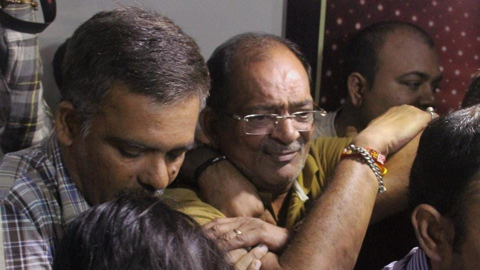 Police and income tax officials detain real estate businessman Mahesh Shah who declared Rs 13,860 crore under IDS, in Ahmedabad on Saturday.