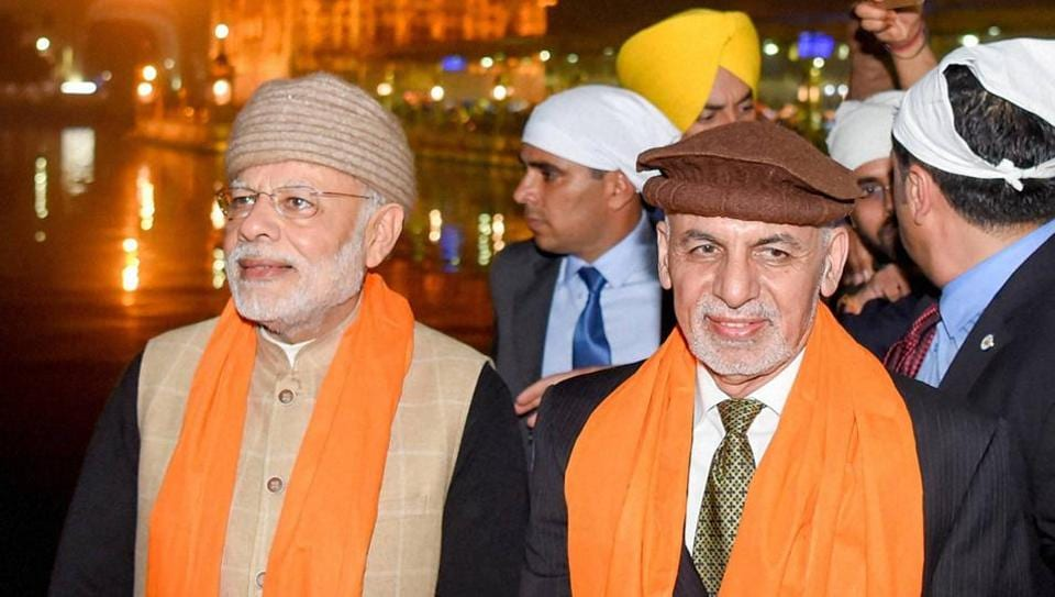 Prime Minister Narendra Modi and Afghanistan's President Ashraf Ghani at Golden temple on the eve of the Heart of Asia Conference, in Amritsar on Saturday.