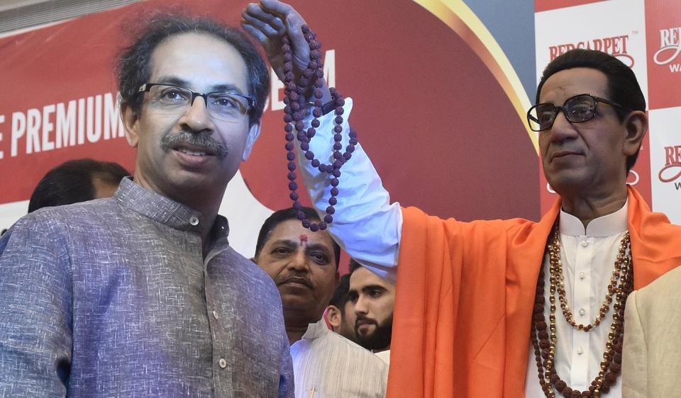 Shiv Sena chief Uddhav Thackeray unveils a wax statue of Bal Thackeray during the inauguration of the Red Carpet Wax Museum at R City Mall, Ghatkopar, on Saturday.