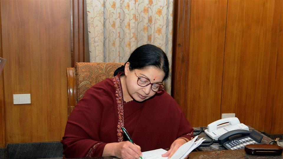Chennai: AIADMK supremo J Jayalalithaa signs a document after swearing-in as Chief Minister of Tamil Nadu at Fort St George in Chennai on Monday. PTI Photo by R Senthil Kumar (PTI5_16_2011_000238B) (PTI)