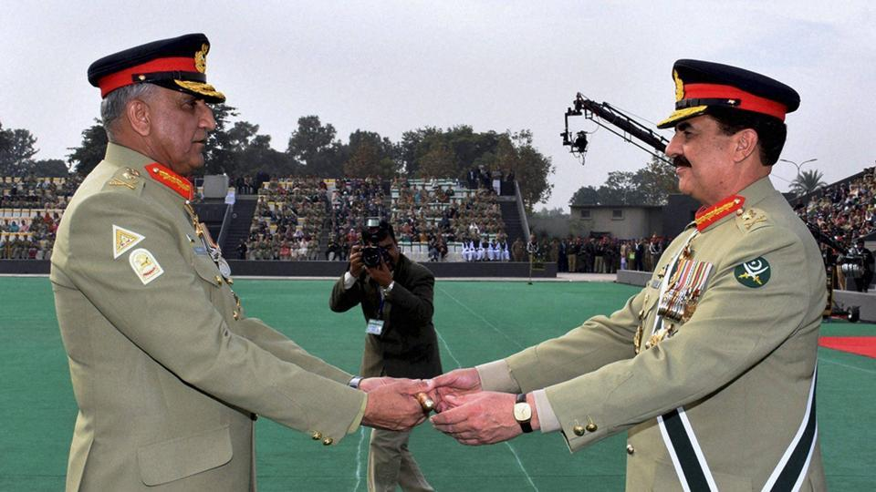 Pakistan's outgoing army chief Gen Raheel Sharif (right) hands over a ceremonial baton to his successor Gen Qamar Javed Bajwa at the Change of Command ceremony in Rawalpindi on November 30.