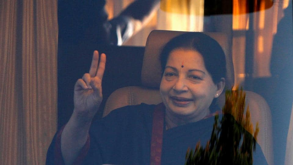 Here, Jayalalithaa  gestures from inside a vehicle after addressing her party supporters during an election campaign rally in Chennai (REUTERS)