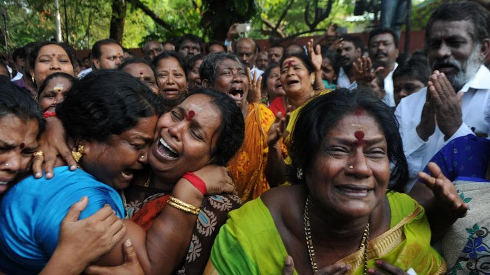 Supporters of Tamil Nadu chief minister Jayalalithaa  react outside the hospital where she is undergoing treatment after cardiac arrest on Sunday.  (AFP)