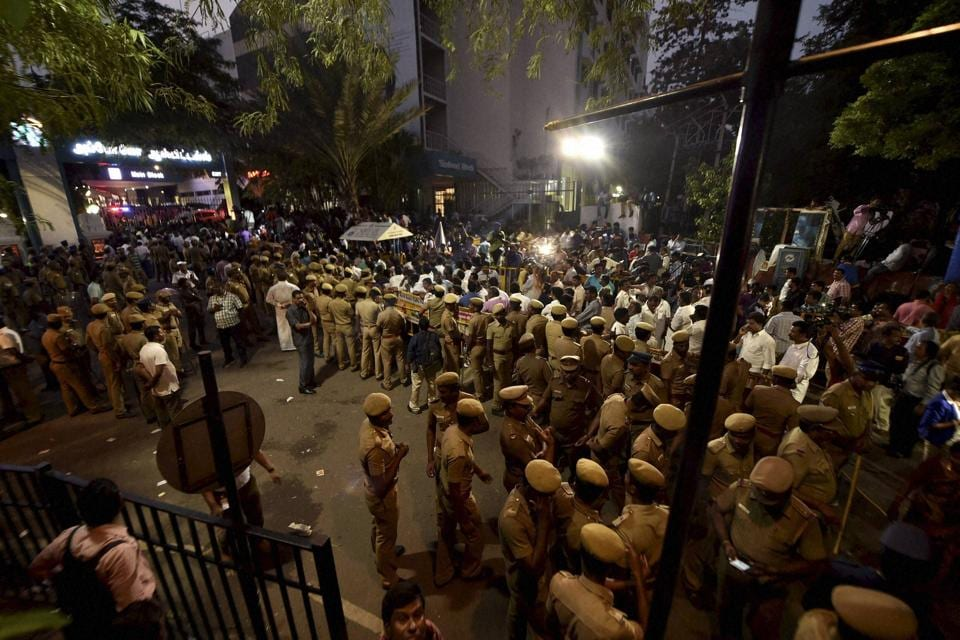 Tamil Nadu police personnel guard the  main gate of the Apollo hospital, where AIADMK supremo and Tamil Nadu chief minister J Jayalalithaa suffered a cardiac arrest. (PTI)