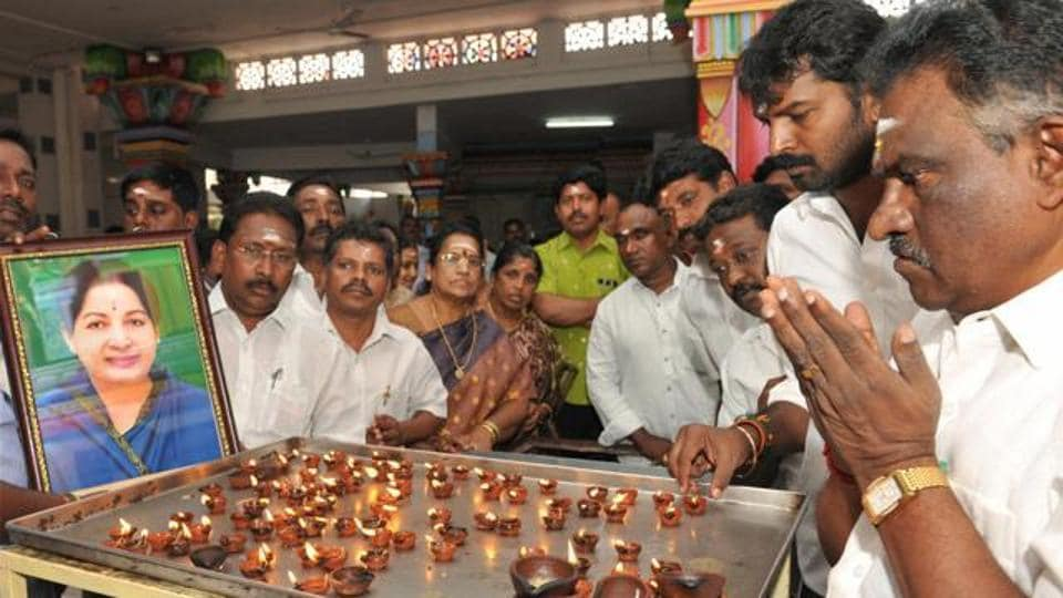 AIADMK MLA Amman Arjunan, along with party members, offers prayers at the Lord Murugan Temple for the recovery of Jayalalithaa, in Coimbatore. (PTI)