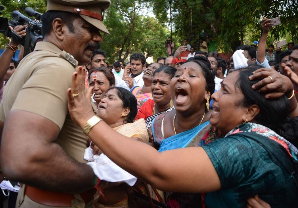 Supporters of Tamil Nadu?chief minister Jayalalithaa react outside the hospital where she is undergoing treatment after cardiac arrest on Sunday.  (Srinivasulu/ HT Photo)
