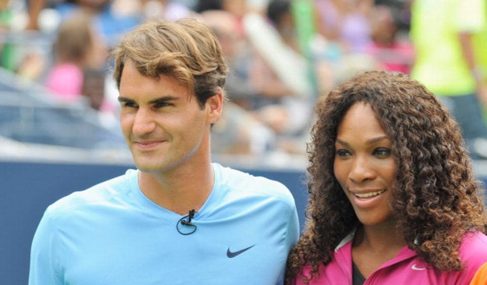 Roger Federer (L) and Serena Williams attend Arthur Ashe Kids' Day at the USTA Billie Jean King National Tennis Center.