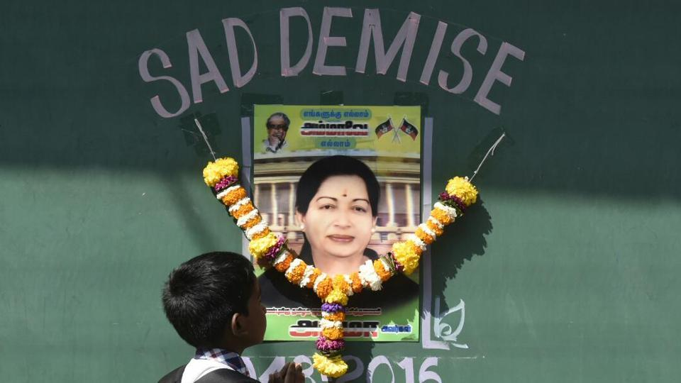 A child pays tribute to Jayalalithaa at Rajaji Hall in Chennai, where her body rests before cremation.