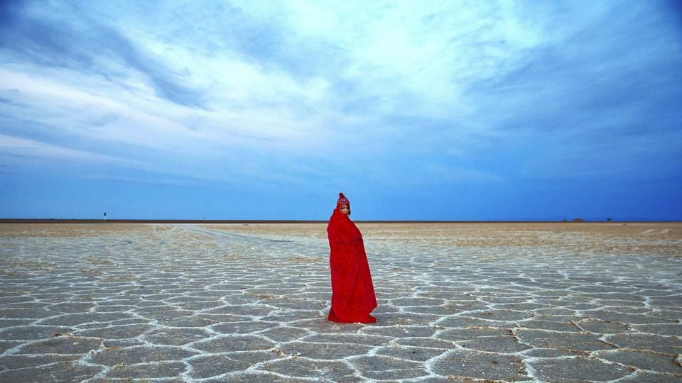 The Mesr desert, about 305 miles (500 kilometers) southeast of Tehran, is a desert and also an oasis located in central Iran. An Iranian woman covers herself with a blanket due to the cold, while visiting Khour salt lake in the desert.  (AP)