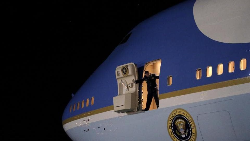 An Air Force officer opens the door of Air Force One as US President Barack Obama arrives at Joint Base Andrews from New Jersey and New York, in Maryland.