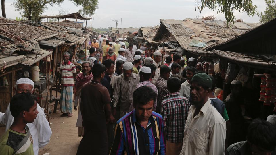 Rohingya from Myanmar make their way in an alley at an unregistered refugee camp in Teknaf, near Cox's Bazar, in Bangladesh.
