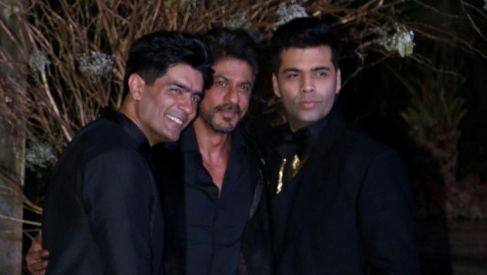 Birthday boy Manish Malhotra with filmmaker Karan Johar and actor Shah Rukh Khan. (IANS)