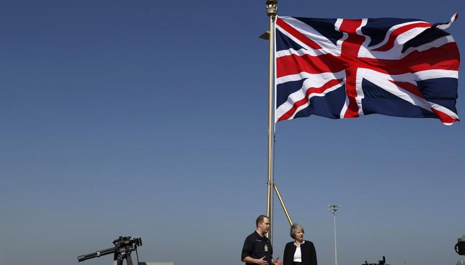 Britain's Prime Minister Theresa May visits HMS Ocean in Manama, Bahrain on December 6, 2016.