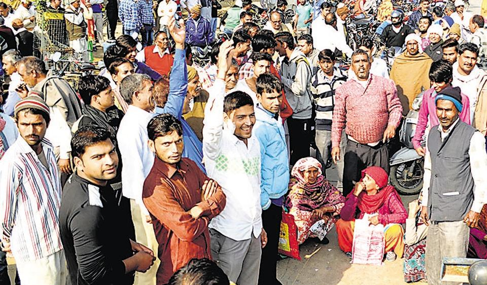 Villagers block traffic on the Pataudi-Haily Mandi road in Pataudi on Tuesday as the banks did not open due to cash crunch.