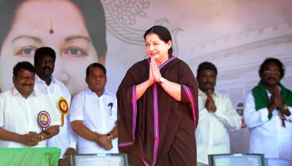 This file photo taken on March 27, 2014 shows All India Anna Dravida Munnetra Kazhagam (AIADMK) leader and chief minister of the southern Indian state of Tamil Nadu J Jayalalithaa gesturing as she arrives at a public meeting in Pondicherry.