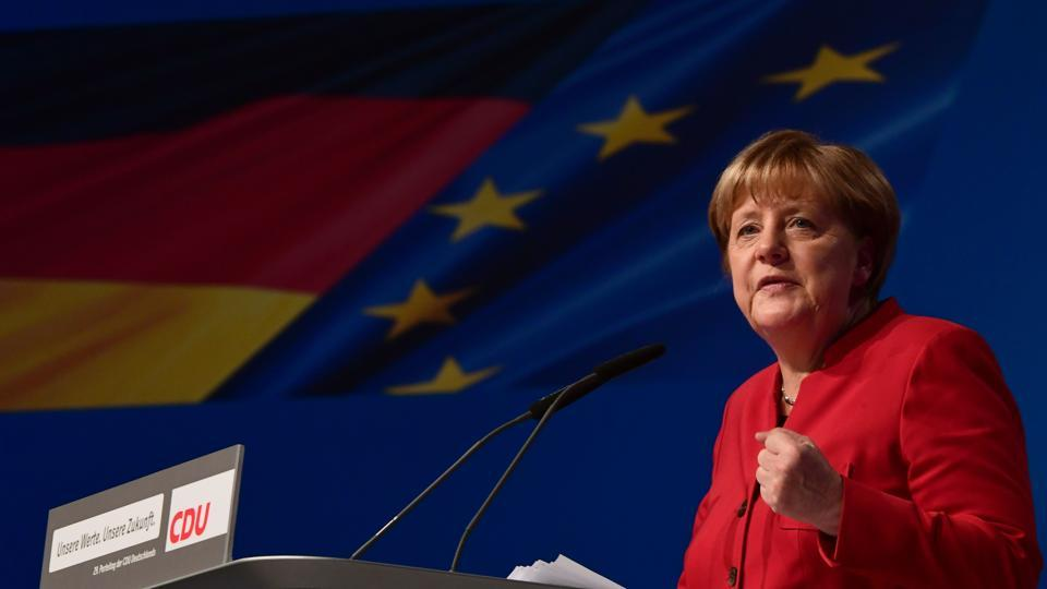 German Chancellor Angela Merkel addresses delegates during her conservative Christian Democratic Union (CDU) party's congress in Essen, western Germany, on December 6, 2016. German Chancellor Angela Merkel launches into campaign mode for elections taking place in 2017.