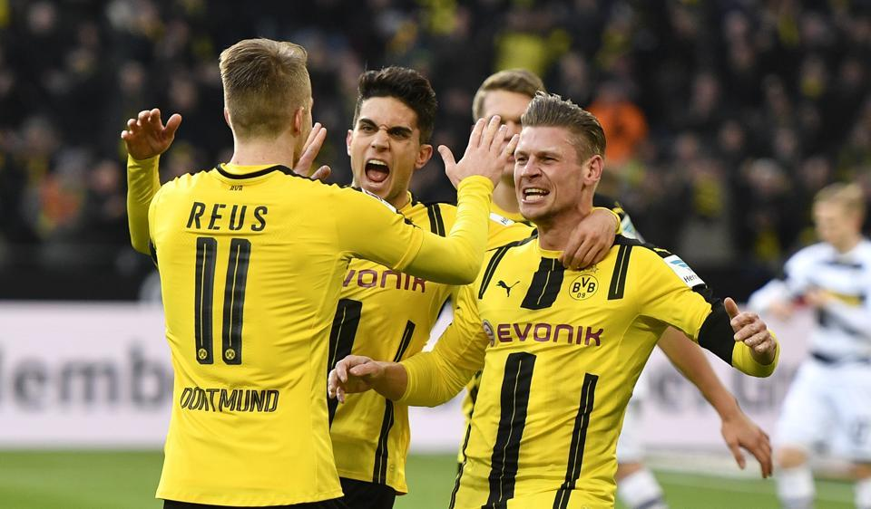 Dortmund's man of the match Marco Reus is congratulated during the German Bundesliga soccer match between Borussia Dortmund and Borussia Moenchengladbach in Dortmund, Germany, Saturday, Dec. 3, 2016. (AP Photo/Martin Meissner)