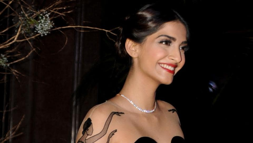 Sonam Kapoor was all smiles as she posed for photographers.  (AFP)