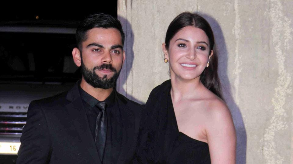 Indian cricketer Virat Kohli and actor Anushka Sharma posed for a photograph during designer Manish Malhotra's 50th birthday in Mumbai on December 5, 2016. (AFP)